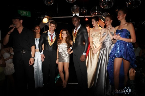 Maria de Guzman and male models in body-painted suits, with models.